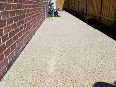 Exposed aggregate concrete from Everlast is an affordable finished product that will put a smile on your face. Best Concrete Paint, Concrete Cost, Stencil Concrete, Types Of Concrete, Concrete Steps, Concrete Driveways, Painting Concrete, Landscaping Design, Front Yard Landscaping