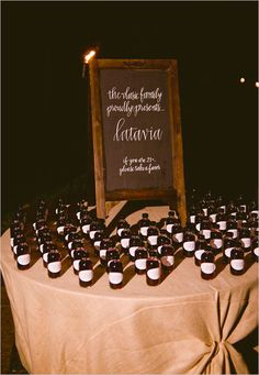 Wedding favor idea -Bottled Latavia Made with wine, Everclear® alcohol, Canadian whisky, sugar and cherries.  http://www.weddingchicks.com/2013/10/21/beauteous-backyard-wedding/