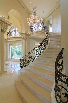 ornate black balusters curved stairs