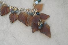 Asymmetrical Amber Colored Glass Leaf Cascade Necklace with Wire Wrapped India Agate Dangles. $39.99, via Etsy.