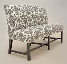 Exposed Leg Dining Bench In A Black And White Buffalo