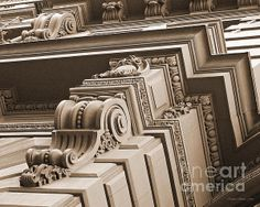 Close-up photo of neo-classical architectural details, as seen in the facade of a vintage building in San Francisco, California. Image has been cropped to an 8x10 and digitally converted to black-and-white sepia in tones of golden taupe.