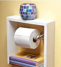 """Shadow Box Frame as a Wall Unit Shelf around Toilet Paper...Click on the image for more information on """"DIY Bathroom Storage"""" by Kitchen Bath Trends"""