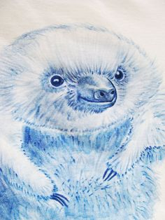 I upcycled this tshirt by hand drawing a baby sloth. Isn't it cute? You can find this at my etsy shop.