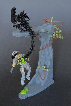 Alien kills Predator with a LEGO flipper http://www.brothers-brick.com/2016/04/11/alien-kills-predator-with-a-lego-flipper/