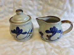 Vintage Art Pottery Cream and Sugar Dishes speckled with blue floral design trimmed in brown Mint Condition by LilRedsRetroFinds on Etsy