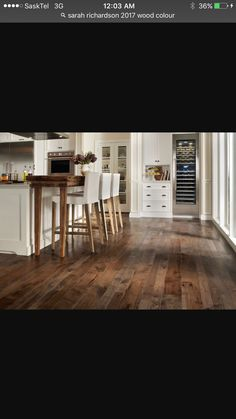 Dark wood with white cabinets. Gray Basement, Basement Colors, Floor Colors, White Cabinets, Dark Wood, Navy And White, Dining Table, Colours, Flooring