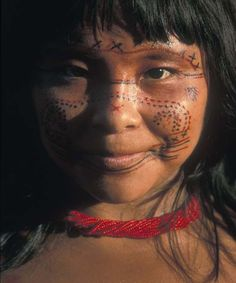 Venezuela ~ Brazil | Young Sanema girl.  Branch of the Yanomi tribe who live in the tropical rain forest on both sides of the Venezuelan and Brazilian border, on the watershed between the Orinoco and the Amazon rivers | ©Bruce Parry, BBC