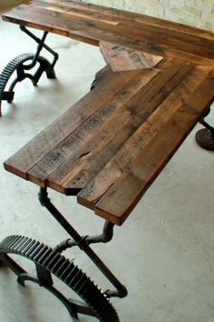 Table made with reclaimed wood and pipes!  Love it!