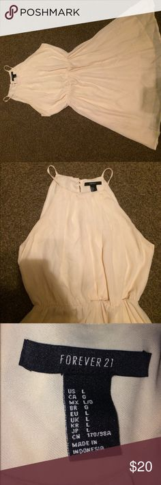 Forever 21 Cream Colored Dress Brand: Forever 21 - Very comfortable! Only worn 5 times,  a tad open back, a little bit above knee (I'm 5'5 so may vary), can fit a size medium, cream colored, and has never been shrunk due to being only dry-cleaned. Will take any tradings! Also, if you'd like to see more photos of the dress or have any questions or concerns feel free to comment below! Forever 21 Dresses Midi