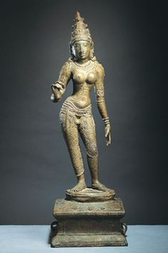 #Parvati  #India, Tamil Nadu; Chola period (880-1279), 11th century  In this representation, Parvati holds her right hand in a distinctive gesture in which the fingers are curved and the thumb and forefinger touch, indicating that she is holding a flower. Parvati can also be identified by her conical crown with its three mountainlike tiers. The goddess stands in a triple-bend pose with a pronounced thrust of the hip and her left arm and hand held down in a dance gesture. #hindu #shiva