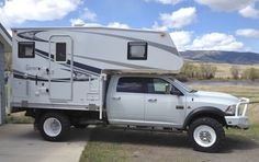 Northstar makes flatbed campers that will fit on an F-550 flatbed, so I wouldn't have to pay for extra mods on the F-550 chassis-cab.  It looks more streamlined and would probably give more storage accessible from the interior, too.  I'd still add custom storage boxes below the bed, in front of and behind the tires.