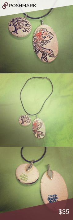 2 Handcrafted Pendants & Necklace 2 Pendants made by Cheryl Stevens Studios, and 1 nylon necklace. 1 pendant features a tree, and the other features a koi fish. Both are so gorgeous!☺️💕🌺 New! Handmade Jewelry Necklaces