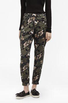 <ul> <li> Lightweight draped trousers in soft-touch lyocell</li> <li> Camouflage and floral print</li> <li> Elastic waistband and ankle cuffs</li> <li> Relaxed fit</li> <li> UK size 10 inseam length is 73cm</li> </ul>