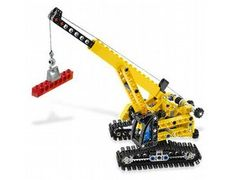 The Tracked Crane from Lego - a great selection of Lego construction sets at Wonderland Models.    One of our favourite sets in the Lego Technic range is the Tracked Crane.    The Tracked Crane goes places where no ordinary crane can! Manoeuvre it into position, rotate the superstructure and raise the boom. For extra-long reach, extend the arm and lower the hook into position. It's just like the real thing! Rebuilds into a bulldozer with a lowering blade and ripper!