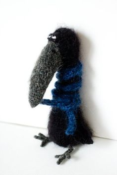 bird with blue scarf