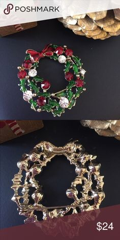 """Vintage Christmas Wreath Brooch Pin Gorgeous vintage gold-tone Wreath Brooch with a red enameled bow, green enameled leaves, and brilliant red and white rhinestones for the balls! Measures 2"""" in diameter. Vintage Jewelry Brooches"""