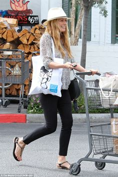 Beaming beauty: Beaming as she shopped for food at the Bristol Farm market, the 38-year-ol...