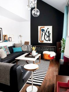 an angled black painted accent wall in this house spotted on sfgirlbybay