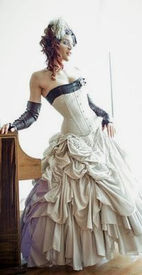 From the Steampunk Fashion Guide to Skirts & Dresses: Bustle Skirts - an example of a steampunk bride wearing a white floor length bustle skirt