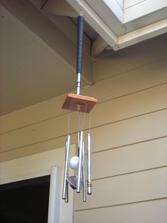 Repurpose golf clubs from thrift store into wind chimes