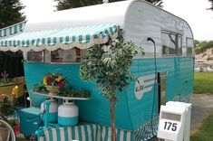 Love the stripe awning and the little skirt across the bottom. 1955 Aljoa Trailer