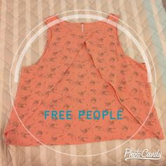 """Pretty, Flowy Free People Top Beautiful peach and grey printed tank with flowy layers. Cute opening in the front! Bust is 22"""" across. Length from shoulder to hemline is 22.5"""". Runs a little big/looser fit. New with tag! Free People Tops Tank Tops"""