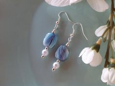 Check out this item in my Etsy shop https://www.etsy.com/listing/230284996/moonstone-earrings-pale-blue-earrings