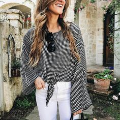 brighton keller wearing gingham top with white jeans and black sunglasses