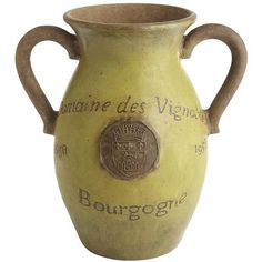 Green Vineyard Vase - Classic French script and a medallion seal create the Provencal look of this rustic vase collection.