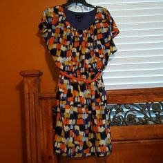 AB Studio Colorful Dress Beautiful, colorful paintbrush pattern elastic waist dress. It has vibrant orange, purple, white, light blue, black and gold colors throughout. It has a new orange belt that comes with the dress. It is 100% polyester, but feels soft and fresh like silk. It has two convenient side pockets and cute drape sleeves. It has a purple lining at the top area. Gently used, a couple of times. AB Studio Dresses Midi