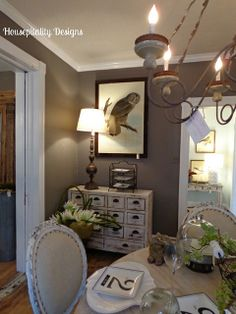 Dining room vignette with taupe walls, distressed white furniture  from Lucketts via Savy Southern Style blog