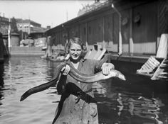 1938 : Woman holding up an eel in the fish hall at Gamla stan (Old Town), Stockholm, Sweden. Laurel And Hardy, Vintage Photographs, City Life, Alter, Old Town, Black And White, People, Stockholm Sweden, Woman