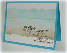 Stampin' Up! ... handmade card from stampsnsmiles.blogspot.com ... soft watercolor look in blues and browns ... wide band for the scene with torn edge paper masked edges ... shore birds running o the beach ...
