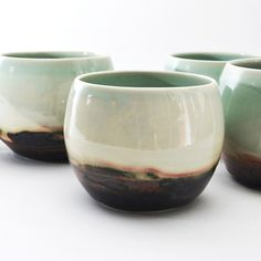 "set of 2 porcelain tea bowls. approx 3.5"" wide, 4"" high. each one has it's own unique markings, and shapes vary slightly.glazed glassy minty green on the inside. exterior is glassy blue/green with some shades of cream, pink, dark blacks and browns.food/dishwasher safe.all items in this store are made in the wabi sabi tradition. crazing, crackling, and other irregular textures and surfaces are part of the handmade nature, and should be embraced."
