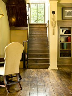Consider using a wide plank, like those pictured here. They are inherently more homey than narrow oak strips and are readily available, even...