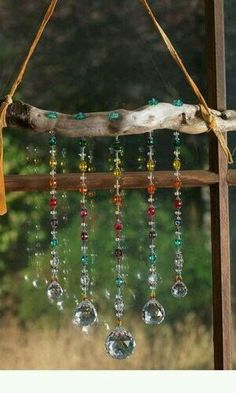 Driftwood branch strung with leather (chain might be better) and bright reflective beads as suncatcher - Fire Mountain Gems, designed by Mary Wertz, includes materials list Diy And Crafts, Arts And Crafts, Cork Crafts, Shell Crafts, Upcycled Crafts, Homemade Crafts, Resin Crafts, Bottle Crafts, Creative Crafts