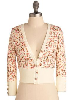 Would be cute if the shirt you'd wear underneath had lace trim at the neckline and the hem of the shirt. Pretty, feminine cropped cardigan