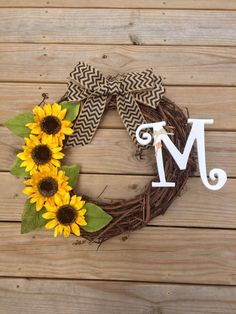 A personal favorite from my Etsy shop https://www.etsy.com/listing/279210084/sunflower-monogrammed-grapevine-wreath