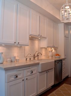 Suzie: Turquoise LA - Lovely galley kitchen design with white shaker kitchen cabinets, subway ...