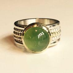 Ring van zilver en goud met een peridot