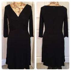 Black rayon blend LOFT dress Pretty and classic black rayon blend dress. Fitted top and waist with a full skirt. Back zipper. 3/4 sleeves. LOFT Dresses