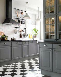 IKEA kitchen with gray cabinets and black and white checkered floors, via @sarahsarna.