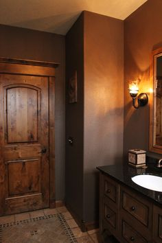 Interior Doors | knotty alder two-panel door with one of our door toppers, finishes off this  cozy powder room | Bayer Built Woodworks, Inc.