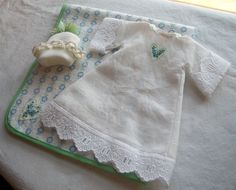Infant burial gown with hat and blanket.
