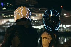 We've seen simultaneous nods to motorcycle safety and TRON light cycles with bike wheel lights. LightMode kits propose something similar with bike helmet lights. More specifically, ropes of EL material riders DIY around their protective wear for Motorcycle Helmet Accessories, Cool Motorcycle Helmets, Cool Motorcycles, Motorbike Clothing, Biker Accessories, Motorcycle Equipment, Futuristic Motorcycle, Women Motorcycle, Yzf R125
