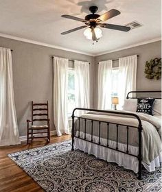 Relaxing Master Retreat | Neutral gray walls, crown molding, refinished wood floors and plenty of natural light come together to create a dreamy master bedroom.
