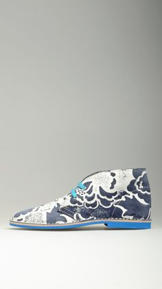 Blue patterned suede lace-ups desert boots characterized by contrast polka-dot lining,  sky blue cotton laces, leather midsole, antioxidant eyelets, raw edge stitching, rubber sole, desert boots manufacturing process, 100% finest suede and split grain leather.