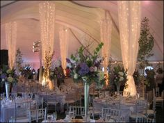 Love the light columns. Hula hoop at the top, icicle lights and gossamer. Easy!
