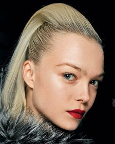 Sleek hair with megavolume and flawless red lips looks put-together and sophisticated glam